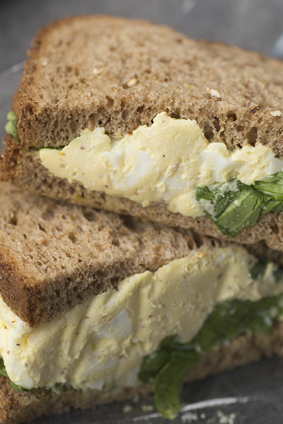 I like egg salad as a breakfast sandwich.Starbuck's egg salad has chives for a little peppery punch and they serve it with arugula on cider wheat bread.