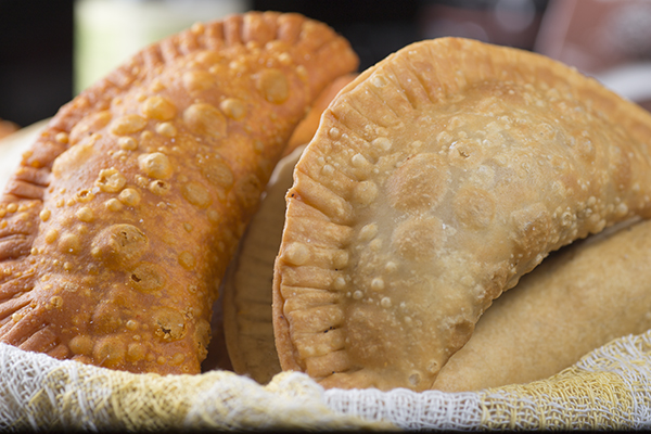 Empanadas with picadillo and Jamaican Patties with curried beef.