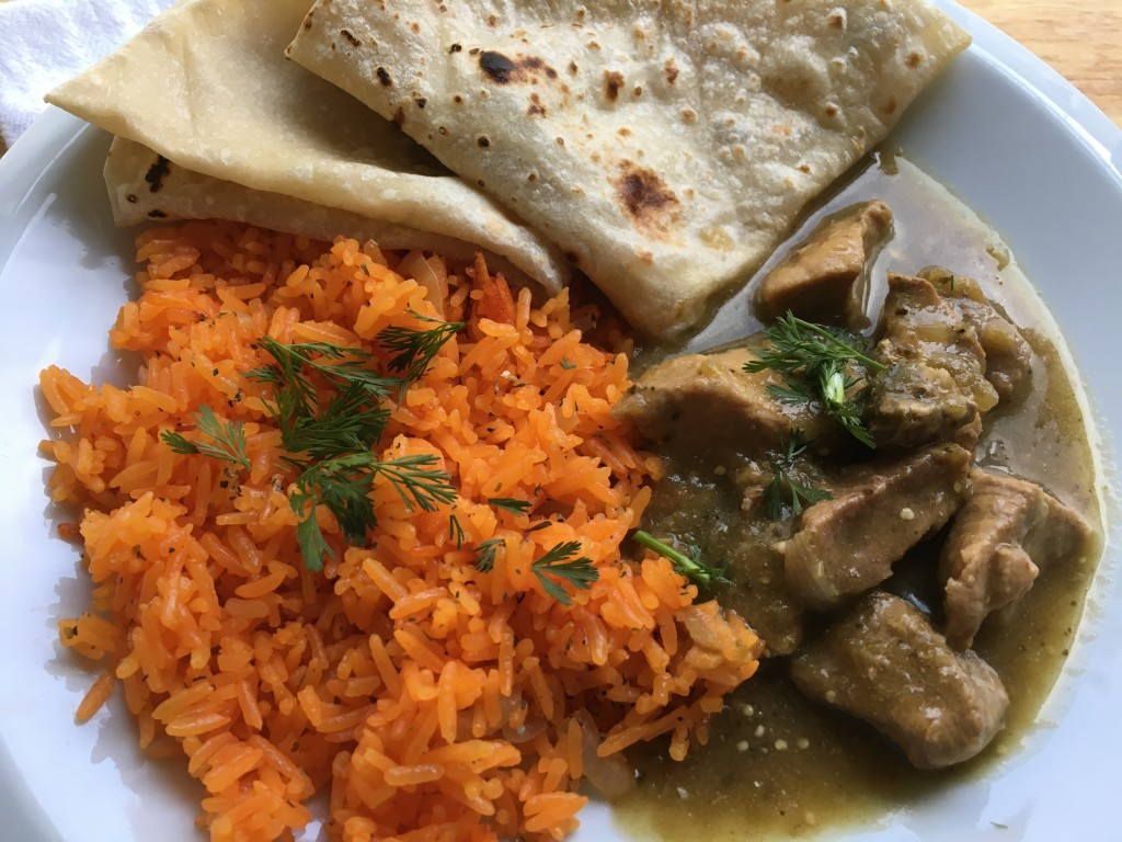 Chile Verde served with flour tortillas and Spanish Rice.